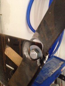 Improper alteration caused damage to arm bracket