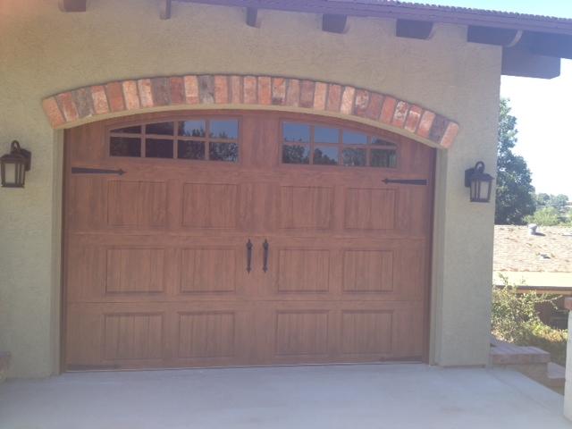 A thing of beauty garage door man garage door man for Garage man door