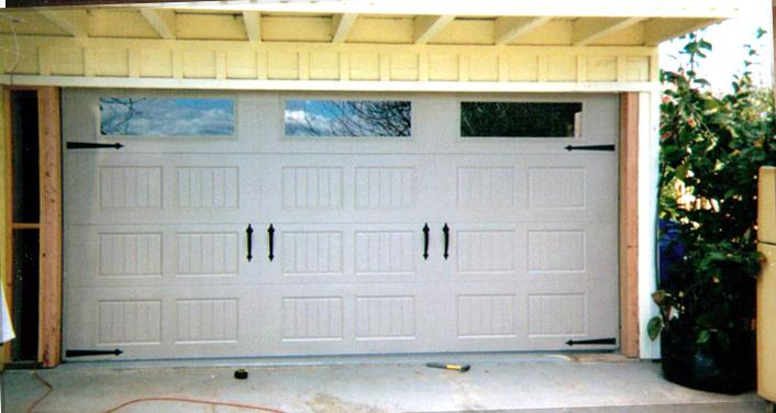 New garage doors custom garage doors garage door man for Man door in garage door